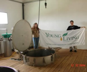 Marc and Mary Lou inspecting a distiller