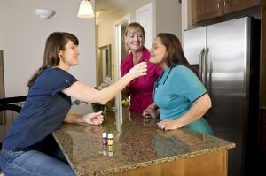 women smelling essential oils