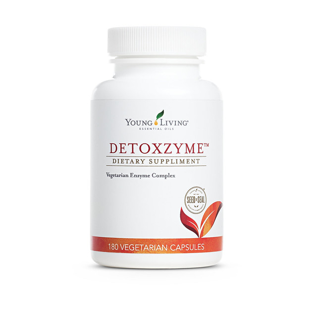 a white bottle of Young Living's Detoxzyme Dietary Supplement