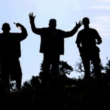 silhouettes of men enjoying life and good health.