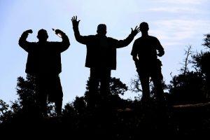 silhouettes of men enjoying life and good health.