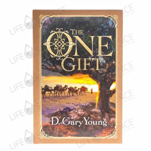 "the cover of the book ""The One Gift"" by D. Gary Young, featuring a frankincense tree in the foreground and a camel caravan in the background."