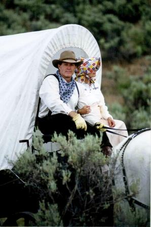 Gary and Mary Young in covered wagon
