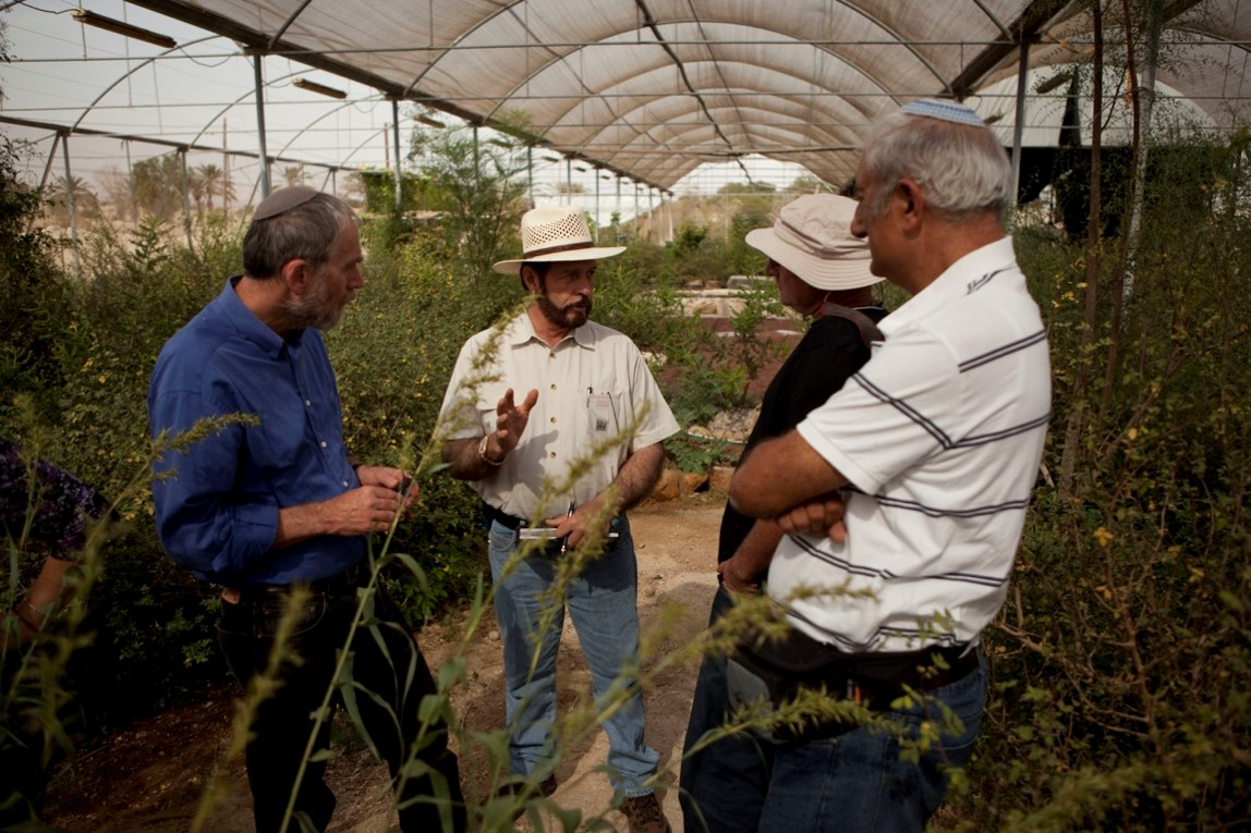Gary is talking with his Israeli partners at his 9th farming and distilling project in the Jericho Valley of Israel where he produced Micromeria for the 2013 Convention. Two large greenhouses are devoted to the development of Balm of Gilead.