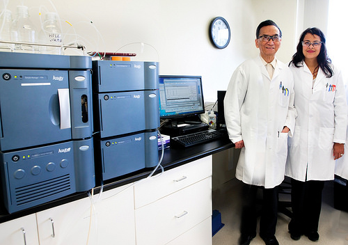 Dr. Chin Chiang, Sr. lab scientist, and Marilyn Contreras-Pinegar, Quality Control manager, are standing proudly next to our new HPLC instrument.