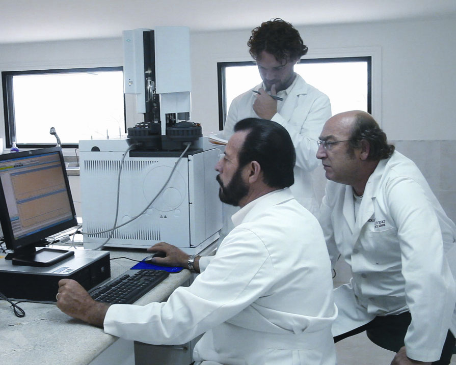 Fine-tuning the GC-MS in the Ecuador lab: Gary with his mentor, Herve Casabianca, PhD, the world's foremost GC-MS expert.