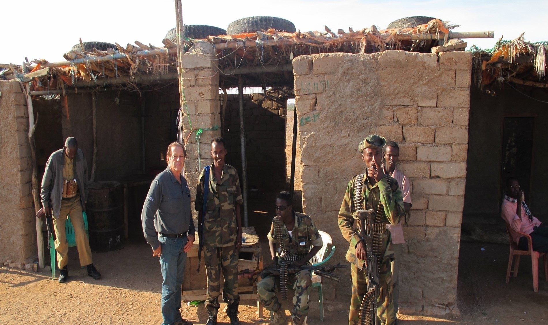 Gary with Somali soldiers tasked with guiding and protecting him on his November 2013 trip.