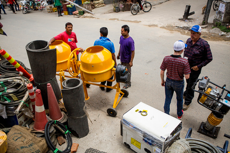 Gary and Jacob buy a cement mixer for the 5 percent cement used to make bricks.