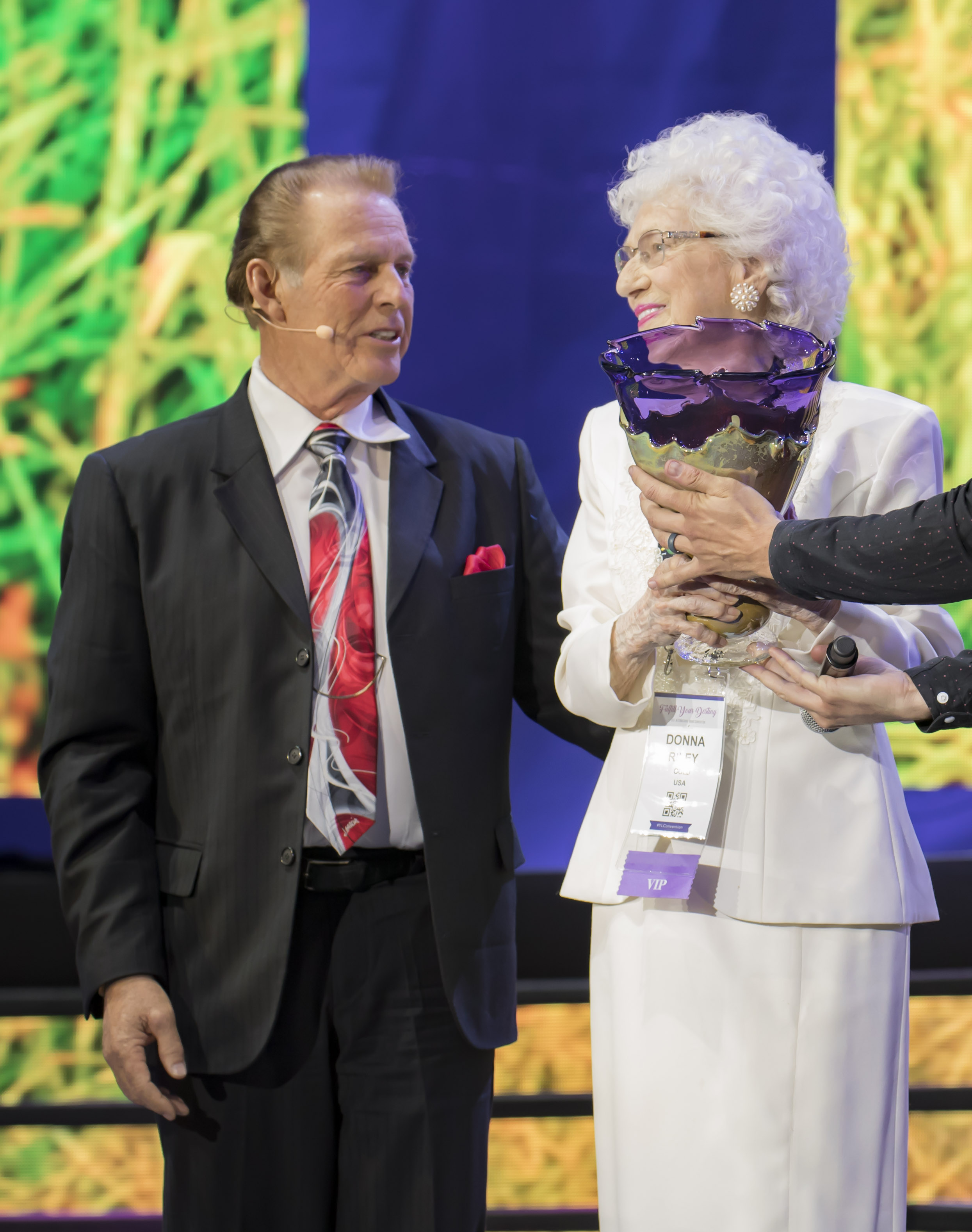 Donna Riley accepts the Spirit of Young Living Award from Gary Young, Convention 2017.