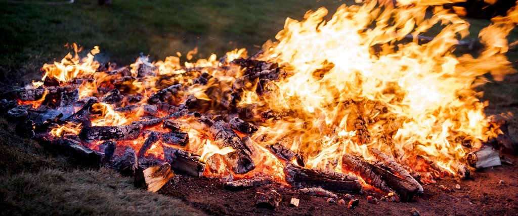 A hot fire being prepared for a fire walk.