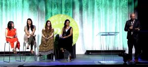 Four women seated on a stage at Young Living International Grand Convention 2019