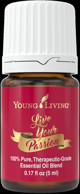 A bottle of Young Living Live Your Passion essential oil blend (red with gold lettering).