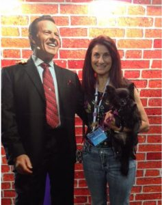 Young Living member Sharon Evans with a picture of founder D. Gary Young
